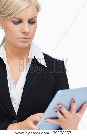 Businesswoman holding a tactile tablet against white background