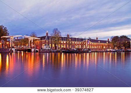 City scenic from Amsterdam at the Amstel in the Netherlands at twilight