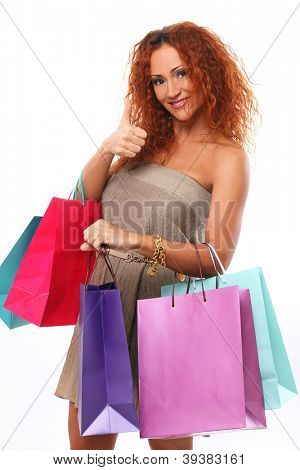 Beautiful redhead woman holding shopping bags