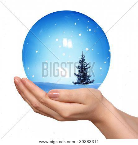 Hand hold snow globe