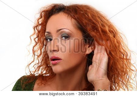 Beautiful redhead woman listening gesture over a white background