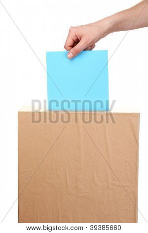 Hand with voting ballot and box isolated on white