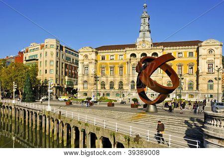 BILBAO, SPAIN - NOVEMBER 14: Town Hall and sculpture Variante Ovoide de la Desocupacion de la Esfera on November 14, 2012 in Bilbao, Spain. The sculpture was designed by Jorge Oteiza