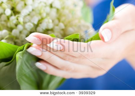 Beautiful Hands With Bunch Of May Lily