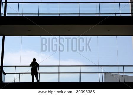 young man inside a modern office building