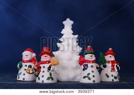 Four Snowmen And White Xmas Tree