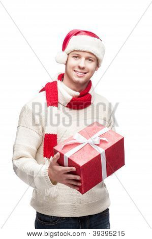 young man in santa hat holding big red christmas gift
