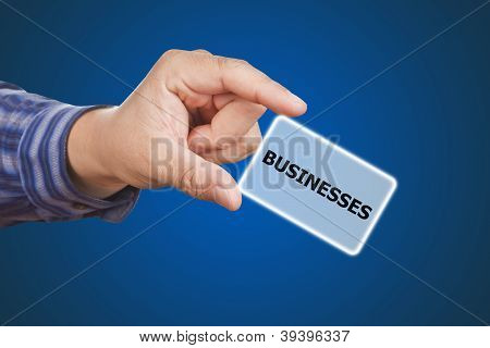 Man Hand Touching Button Businesses Keyword