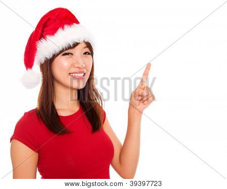 Asian Christmas girl pointing showing blank space, over white background