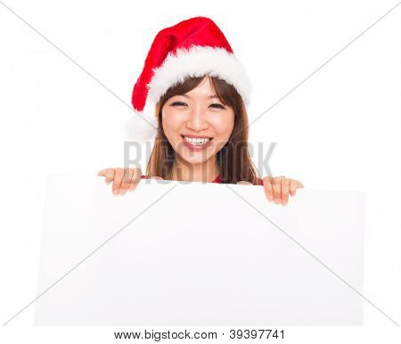 Asian Christmas woman wearing Santa hat over billboard sign, isolated on white background.