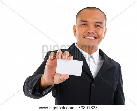 Mature Southeast Asian businessman holding business card, focus on hand over white background