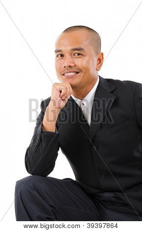 Confident Southeast Asian businessman smiling, isolated white background