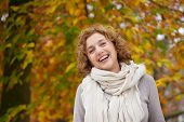 stock photo of mid autumn  - Mature woman smiling in autumn - JPG