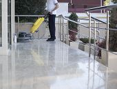 pic of self-employment  - cleaner is cleaning floor with a machine - JPG
