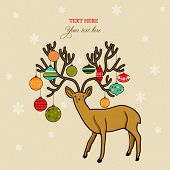 Xmas holiday card with deer and Christmas ornaments on it's horns, doodled design