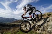 stock photo of biker  - Rider in action at Freestyle Mountain Bike Session - JPG
