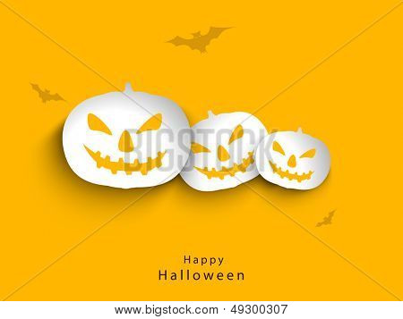 Stickers, tags or labels of halloween pumpkins on brown background.