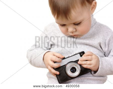 Cute Child Play With Photocamera