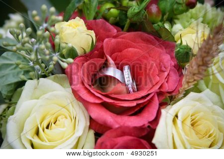 Red Flower And Wedding Ring