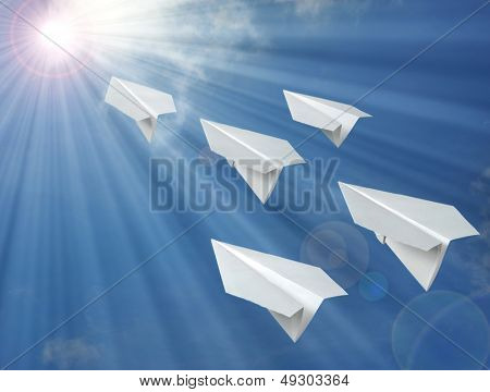 paper airplane in front of blue sky