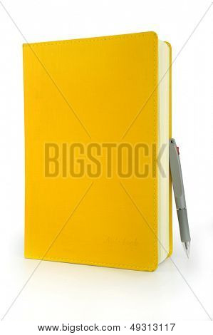 Yellow notebook and pen in the White background