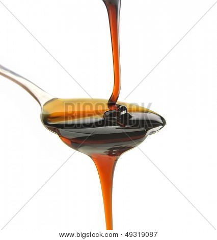 syrup being poured onto a spoon