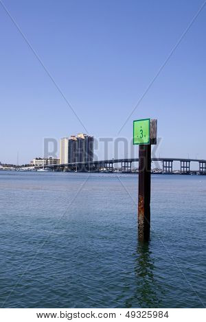 A green marker in the water of the Intracoastal Waterway near West Palm Beach, Florida.