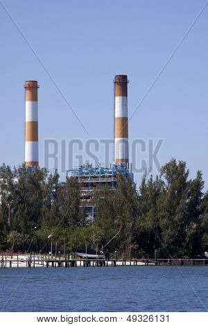 Orange and white striped smoke stacks from a defunct power plant on the Intracoastal Waterway.