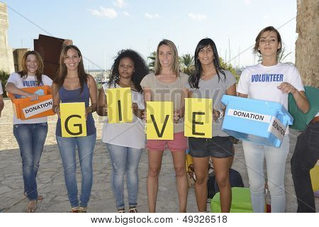 Charity and donation: Vounteer group with letters give