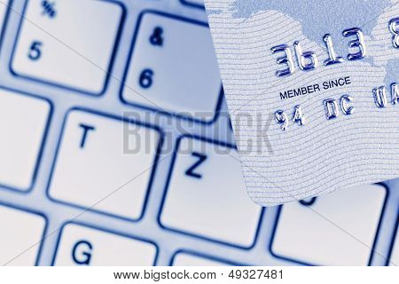 close-up a credit card for cashless payment and keyboard. photo icon for shopping on the internet.