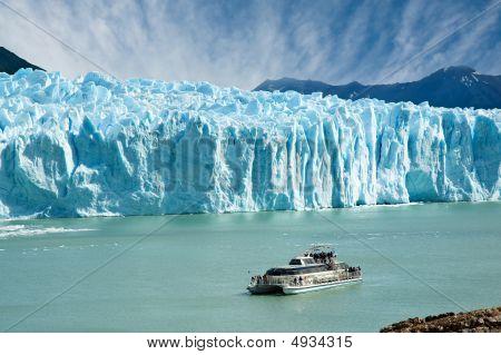Boat Sailing Near Perito Moreno Glacier, In Patagonia.