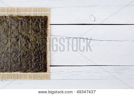 Dried Seaweed And Makisu On A White Table