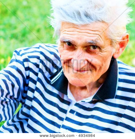 Outdoor Portrait Of Happy Bright Senior Man