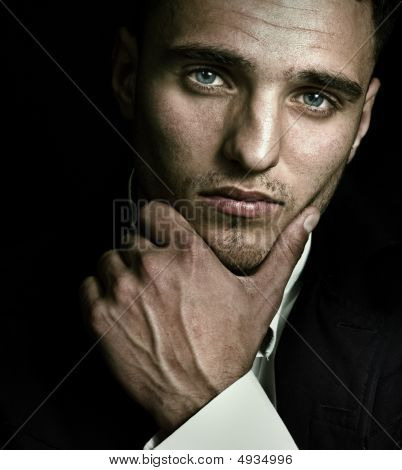 Artistic Portrait Of Handsome Man With Blue Eyes