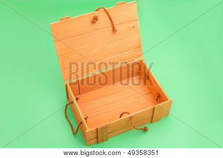 white wooden box on green background