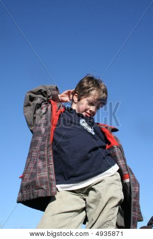 Young Boy Posing With Sky In Background