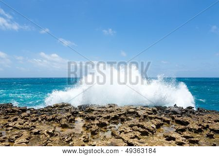 Waves Crashing Over Limestone Ocean Coastline