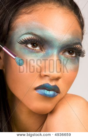 how to do exotic makeup. Stock photo : Mixed Race Woman Advertising Exotic Blue Make Up