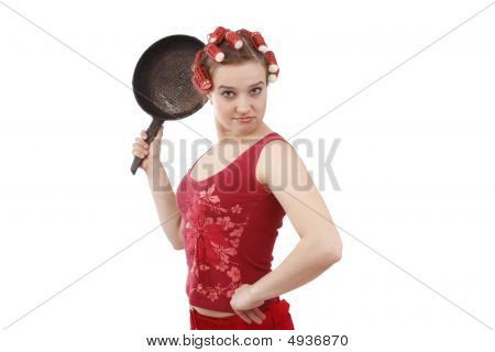 Housewife With Curlers In Her Hair, Holding A Frying Pan.