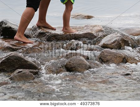 Adult and Child's Feet Walking