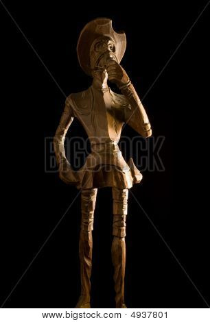 Old Wooden Knight Don Quijote De La Mancha On Black Background.