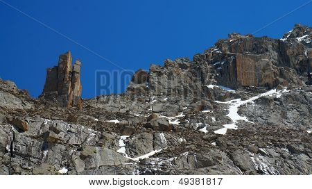 Freakish rocks in Kyrgyz mountains similar to a tower and a square