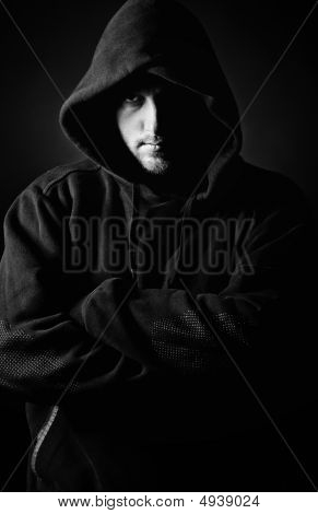 Shot Of A Hooded Youth Against Dark Background
