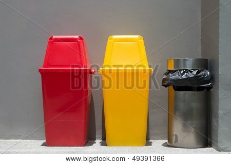 Colorful Bins And Smoke Bin Outside A Building