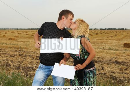 Funny Couple  with Blank Pieces Of Paper