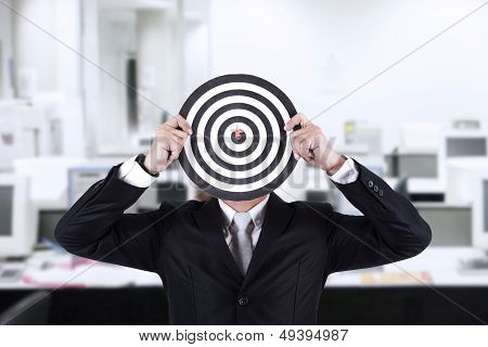 Businessman With Bull's Eye Head At Office