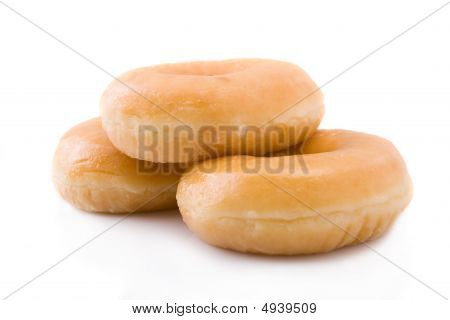 Four Doughnuts Or Donuts Piled