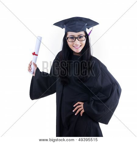 Excited Graduate Student In Gown Posing In Studio
