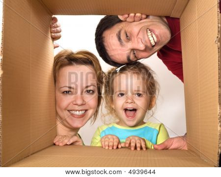 Family Opening Cardboard Box - Happy Moving Concept