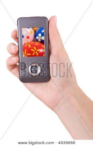 Mão segurando o telefone móvel